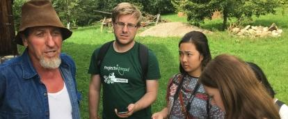 Journalism interns in Romania speak to a local